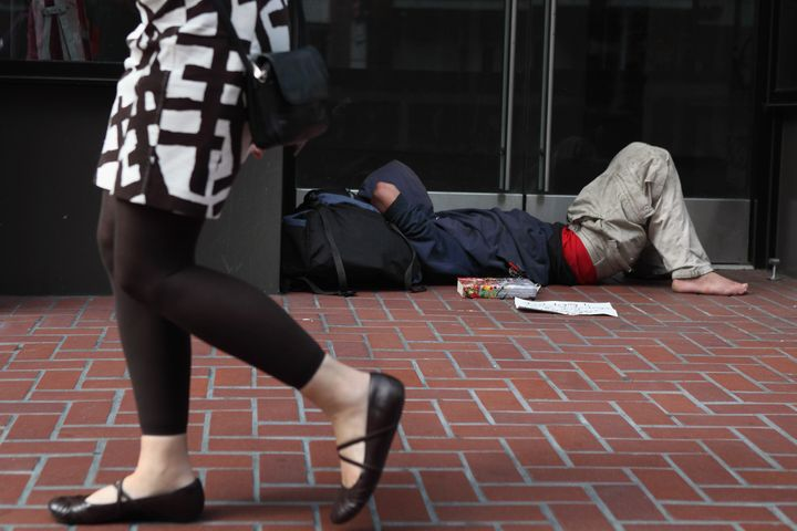 SAN FRANCISCO - SEPTEMBER 16:  A homeless man sleeps in the doorway of a closed store on September 16, 2010 in San Francisco,