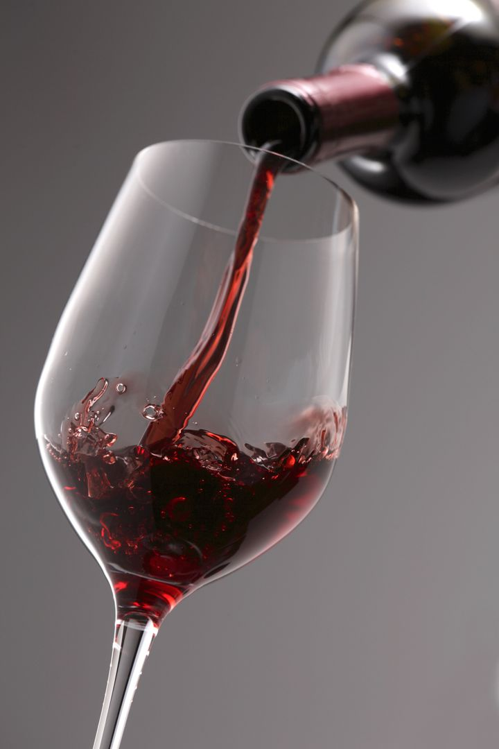 pouring red wine into the wine...