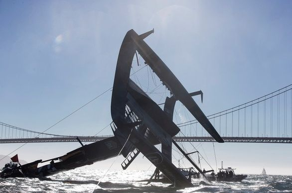 """The <a href=""""https://www.huffpost.com/entry/americas-cup-capsize_n_1972553"""">Oracle America's Cup catamaran flipped over</a> a"""