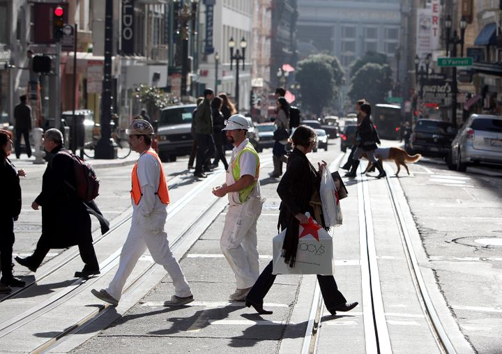 SAN FRANCISCO, CA - JANUARY 14:  A pedestrian carries a shopping bag while walking through Union Square on January 14, 2011 i