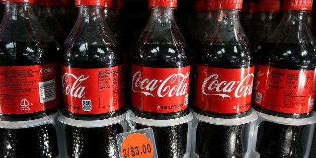 SAN FRANCISCO, CA - MARCH 25:  Bottles of Coca Cola sit in a cooler at a 76 gas station on March 25, 2013 in San Francisco, C