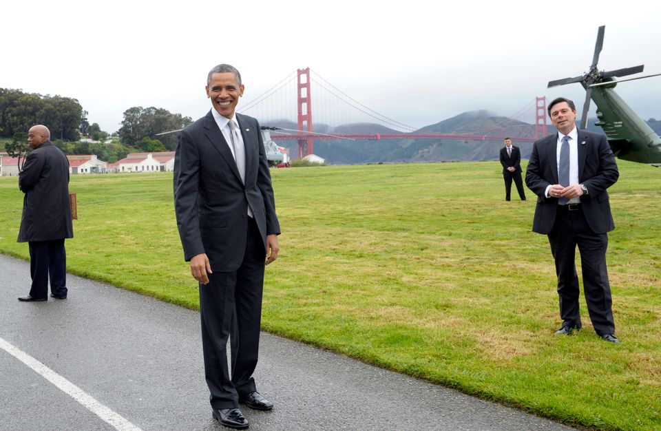 President Barack Obama stands with a view of the Golden Gate bridge before getting on Marine One in San Francisco, Thursday,