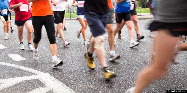 people running in marathon on a ...