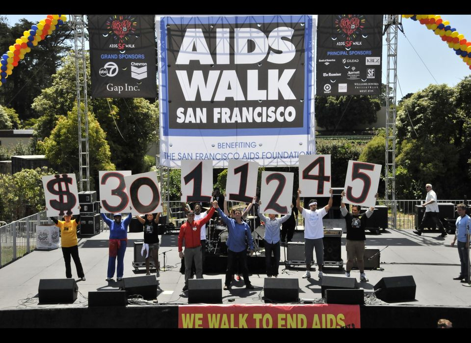 Organizers announce the total amount raised--a whopping $3,011,245--to the cheering crowd.