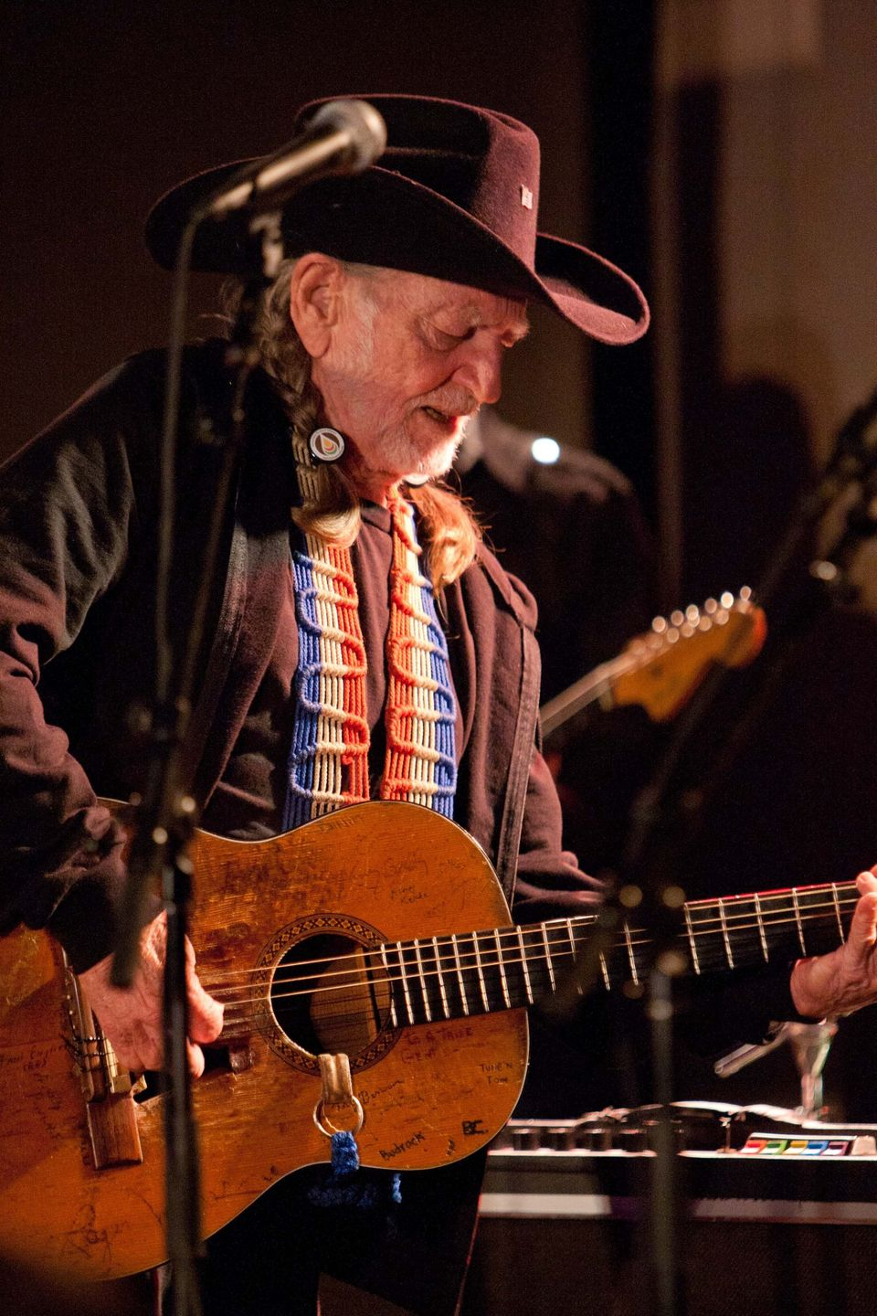 Willie Nelson performs for the crowd.