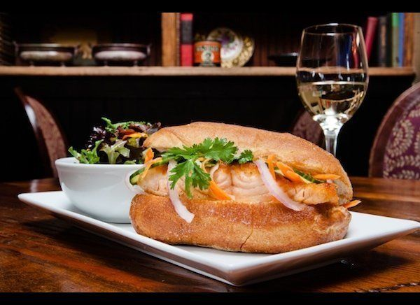 The Roasted Wild King Salmon Banh Mi features plenty of crunch with red onions, English cucumber, pickled carrot and herb sal