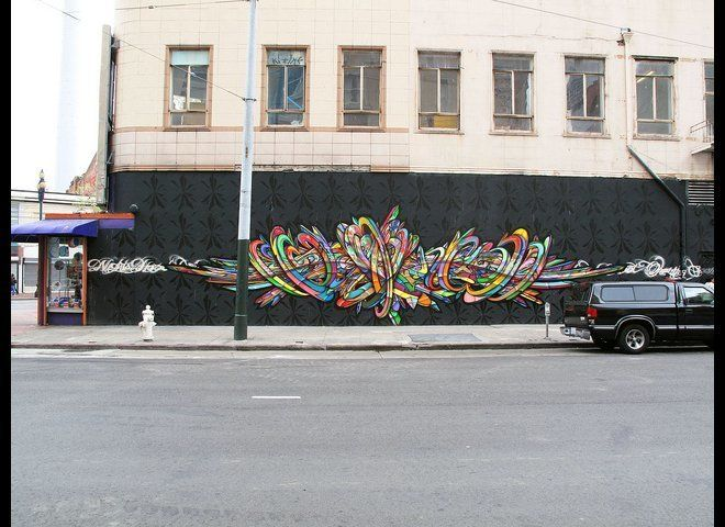 Street art veteran and graffiti writer APEX has graced his magnificent artistry upon a building on Turk Street (at Mason and