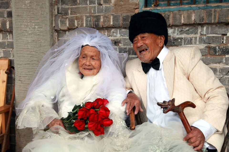 Wu Conghan, 101, and his wife Wu Sognshi, 103, pose for their wedding photos in Nanchong, Sichuan Province, China - 05 Nov 20