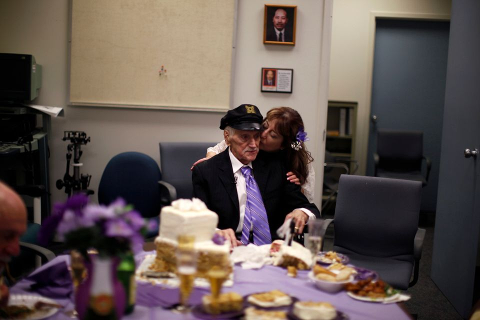 Former Marine Jack Wright (left), 88, sits at the wedding reception after marrying his girlfriend of 30 years, Shirlene King,