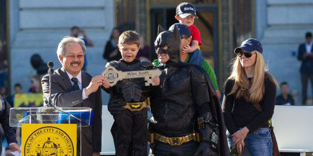 SAN FRANCISCO, CA - NOVEMBER 15:  Batkid Miles Scott receives a key to the city with Mayor Ed Lee, his mother Natalie Scott a