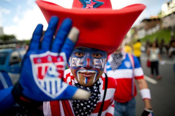 A soccer fan of the United States poses for the picture before World Cup round of 16 match between the U.S. and Belgium outsi