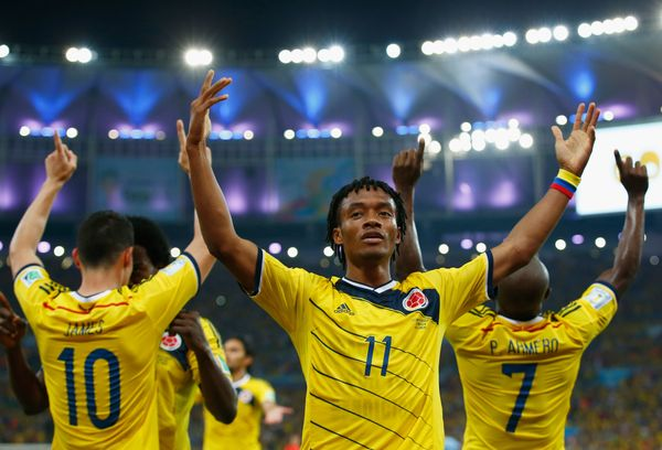 Juan Guillermo Cuadrado of Colombia celebrates his team's second goal scored by James Rodriguez (L) during the 2014 FIFA Worl