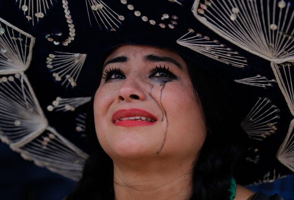A Mexico soccer fan cries after her team was defeat on the World Cup round of 16 match against Netherlands on a live telecast