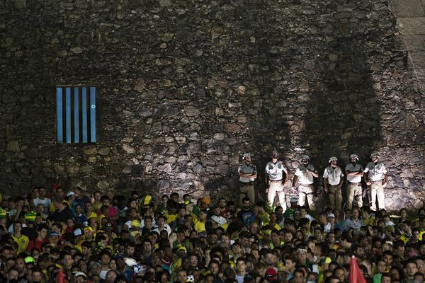 Brazilian supporters watch the 2014 FIFA World Cup Group A football match between Brazil and Cameroon at a FIFA Fan Fest as p