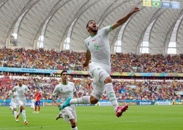 Algeria's Rafik Halliche (5) celebrates after scoring his side's second goal during the group H World Cup soccer match betwee