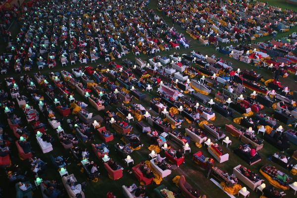 Fans reclining on sofas watch the Germany-Ghana World Cup match at a public viewing at the Alte Foersterei FC Union stadium o