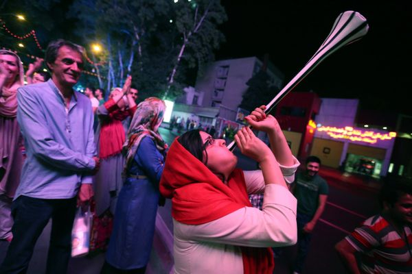 Iran's fans celebrate on Vanak Square, in the capital Tehran, on June 21, 2014, despite their national team narrow defeat to