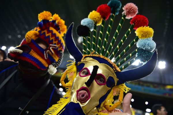 Supporters cheer prior to the beginning of a Group E football match between Honduras and Ecuador at the Baixada Arena in Curi