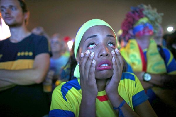 An Ecuador soccer team fan reacts while watching a play against the Honduras team at the Word Cup FIFA Fan Fest during on Cop