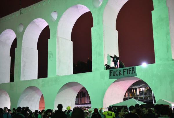 Protestors hang a banner across on Arcos da Lapa bridge in Rio de Janeiro on June 20, 2014, during the ongoing FIFA World Cup