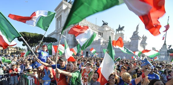 Italian fans watch on a giant screen the World Cup football match Italy vs Costa Rica on June 20, 2014 on the Piazza Venezia