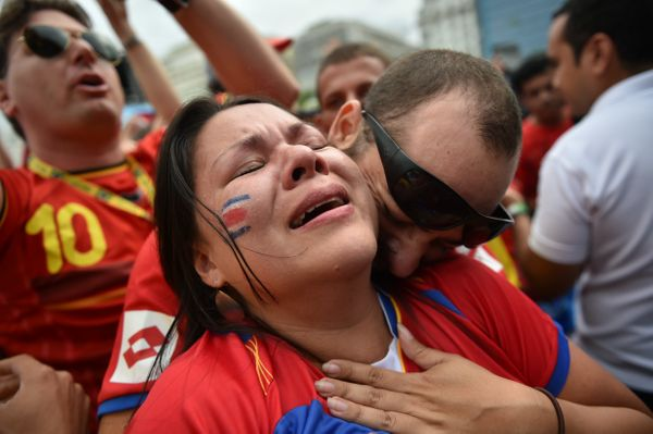 Costa Rican fans react after their team's victory as they watch a telecast on a large screen in Rio de Janerio on June 20, 20
