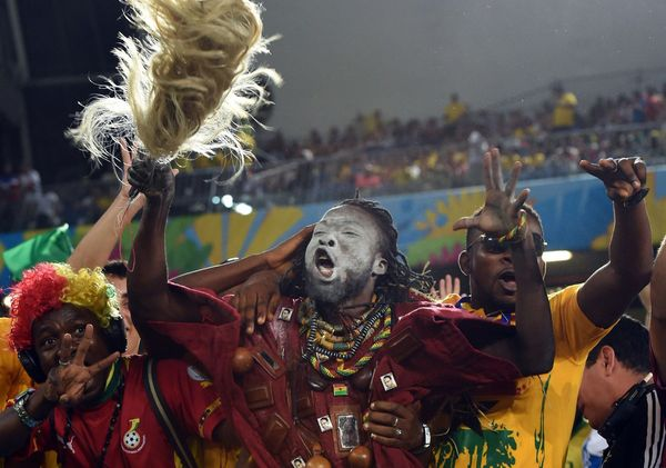 Ghana's fans cheer before the start of a Group G football match between Ghana and US at the Dunas Arena in Natal during the 2