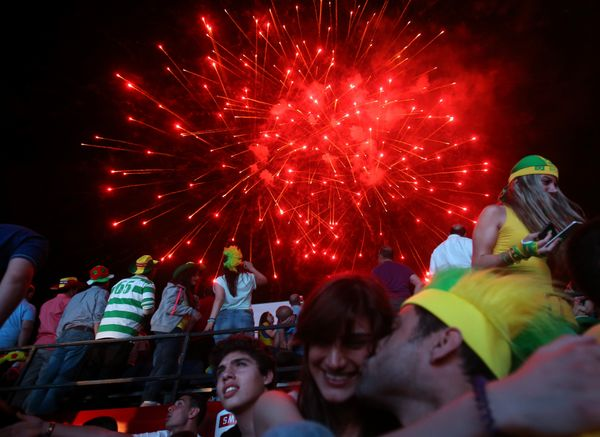 Fireworks are displayed over Lebanese soccer fans who have gathered to watch the first soccer match of the World Cup between