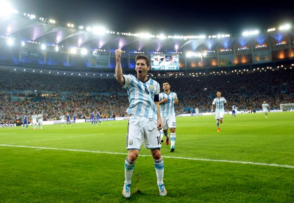 Argentina's Lionel Messi celebrates scoring his side's second goal during the group F World Cup soccer match between Argentin