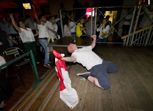 An England supporter reacts in the Walkabout bar in central London on June 14, 2014, after England scored an equalising goal