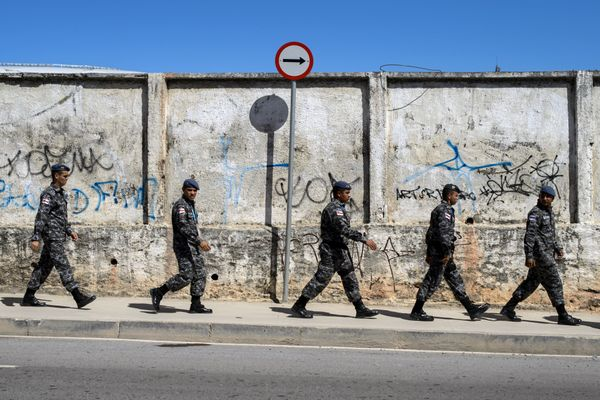 Brazilian soldiers take position in a street next to The Arena Amazonia in Manaus on June 14, 1014, ahead of the England v It