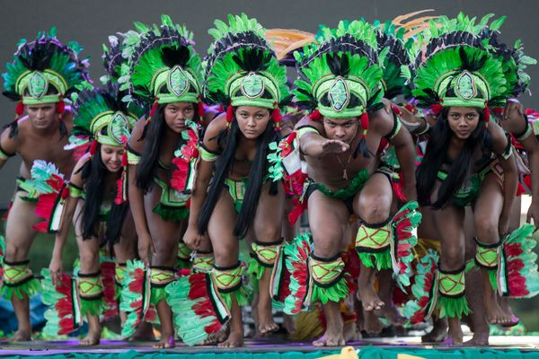 Actors dressed as native Amazonians take part in an outdoor performance in downtown Manaus on June 13, 2014 in Manaus, Brazil
