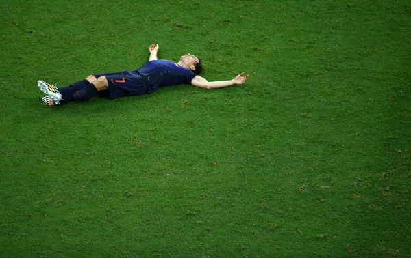 Daryl Janmaat of the Netherlands lies on the field at the end of the match during the 2014 FIFA World Cup Brazil Group B matc
