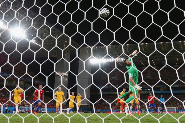 Jorge Valdivia of Chile shoots and scores his teams second goal against goalkeeper Mathew Ryan of Australia during the 2014 F