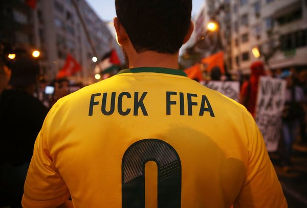 Anti-World Cup protestors gather while attempting to march to Maracana stadium on June 15, 2014 in Rio de Janeiro, Brazil. Th