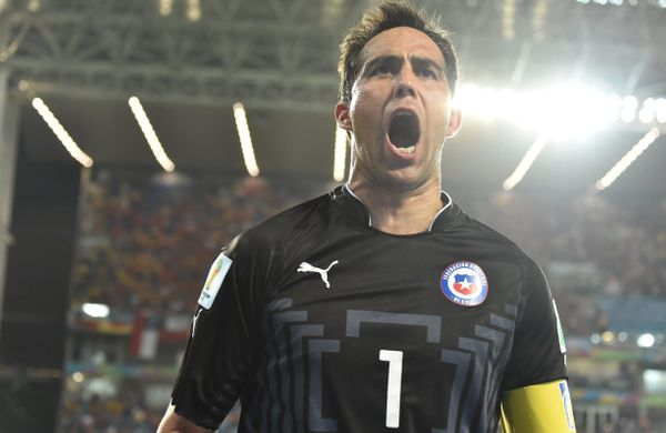 Chile's goalkeeper Claudio Bravo celebrates after his team scored at the end of a Group B football match between Chile and Au
