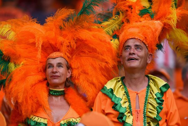 The Netherlands fans look on wearing feathered headdresses during the 2014 FIFA World Cup Brazil Group B match between Spain