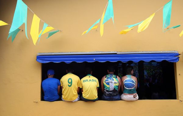 Brazil fans cheer their team during the Group A match between Brazil and Croatia on June 12, 2014 in Porto Seguro, Brazil.  (