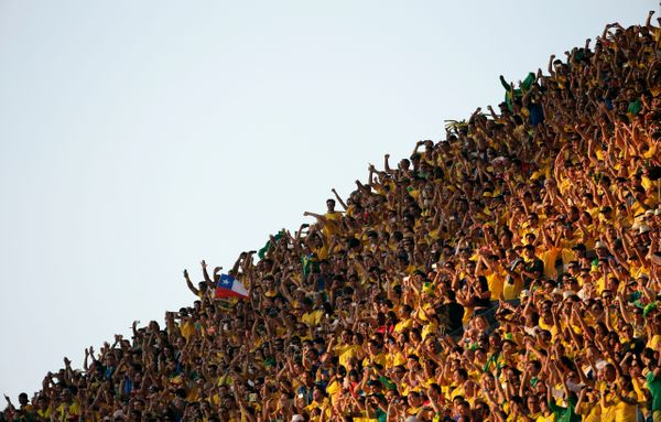 Fans cheer before the group A World Cup soccer match between Brazil and Croatia, the opening game of the tournament, in the I