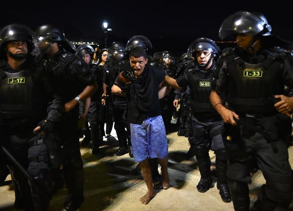 Riot police arrest a protester in the vicinity of the FIFA Fan Fest in Copacabana Beach in Rio de Janeiro, Brazil on June 12,