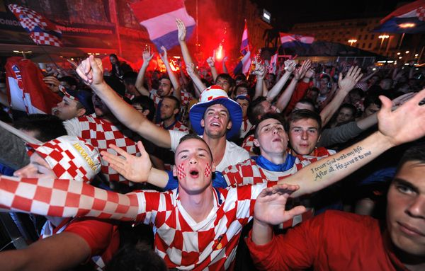 Croatian football fans react as they watch the opening match of the 2014 FIFA World Cup, a group A football match between Cro