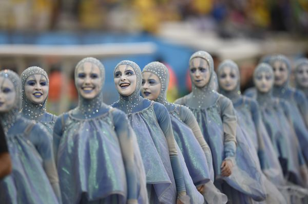 People take part in the opening ceremony of the 2014 FIFA football World Cup at the Corinthians Arena in Sao Paulo on June 12