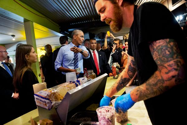 President Barack Obama orders barbecue during a surprise stop at Franklin Barbecue in Austin, Texas, Thursday, July 10, 2014.