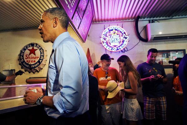President Barack Obama orders barbecue at Franklin Barbecue in Austin, Texas, Thursday, July 10, 2014. Austin is the final le