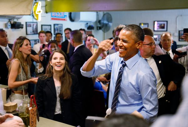 President Barack Obama has a moment with people when he visits Franklin Barbecue in Austin, Texas, Thursday, July 10, 2014. L