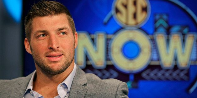 Tim Tebow ponders a question during an interview on the set of ESPN's new SEC Network in Charlotte, N.C., Wednesday, Aug. 6,