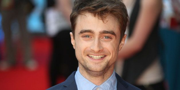 FILE - In this file photo taken Tuesday, Aug. 12, 2014, British actor Daniel Radcliffe reacts, as he arrives on the red carpe