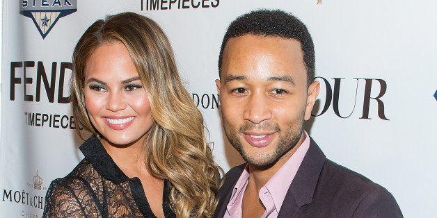NEW YORK, NY - JULY 28:  Model Chrissy Teigen (L) and musician John Legend attend the DuJour celebration of cover star Chriss
