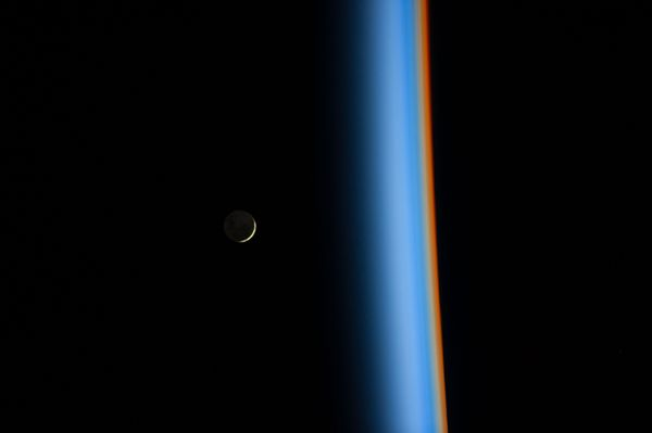 "Astronaut Koichi Wakata tweeted this view of a <a href=""http://www.nasa.gov/content/crescent-moon-rising-and-earths-atmospher"