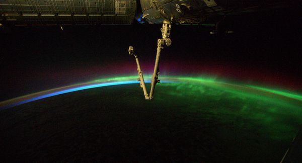 "This photo of a <a href=""http://www.esa.int/spaceinimages/Images/2014/09/Rainbow_aurora"" target=""_blank"">""rainbow aurora""</a>"